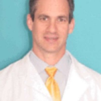 Dr. Travis  Holcombe MD