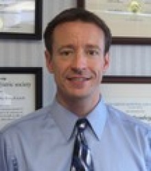 Dr. Christopher James Tolcher  M.D.