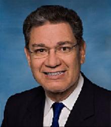 Gustavo  Roman  MD