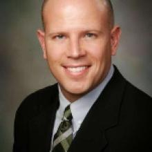 Dr. Bryan L Reuss  MD