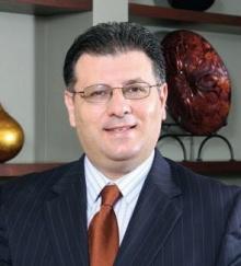 Mr. Rojan  Amjadi  MD