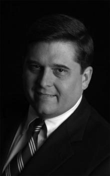 Dr. Charles  Garvin  M.D.