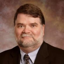Dr. Claude T Falls  M.D.
