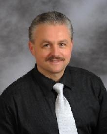 Dr. Adam W Milik  MD