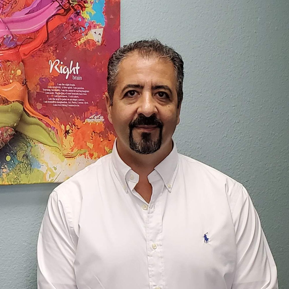 Dr. Basil Abuid, DC, BSc, Chiropractor